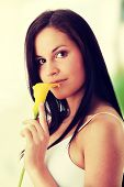 Young beautiful woman with yellow calla
