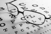 stock photo of snellen chart  - close up of glasses and snellen chart - JPG
