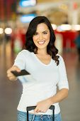 stock photo of over counter  - pretty woman handing over air ticket at airline check in counter - JPG
