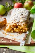 Apple strudel with icing sugar and almond