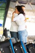 loving couple hugging deeply before parting at airport