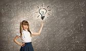 Pretty schoolgirl and light bulb. Idea concept