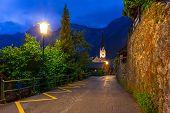 Streets of Hallstatt village in Alps at night, Austria