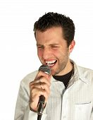 stock photo of nu  - blue eyed young man performing loudly with a microphone isolated over white backround - JPG