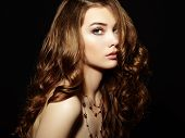 Beauty Woman With Long Curly Hair. Beautiful Girl With Elegant Hairstyle