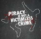 Piracy is Not a Victimless Crime words on a chalk outline of a dead body and blood on the pavement