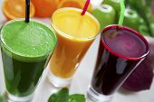 stock photo of fruit-juice  - Fresh beetroot green apple and orange juice - JPG