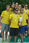 MOSCOW, RUSSIA - JULY 20, 2014: Team Brazil celebrates the 2nd place in ITF Beach Tennis World Team Championship. In the final match Brazil lost to Italy 0-2