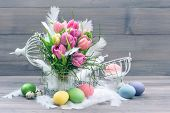 Tulip Flowers And Colored Easter Eggs
