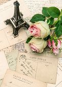 Postcards, Rose Flowers And Souvenir Eiffel Tower