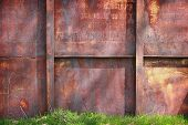 Grunge Rusty Metal Background With A Green Grass