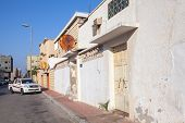 Rahima, Saudi Arabia - May 19, 2014: Ordinary Street View With Parked Car And White Walls, Saudi Ara