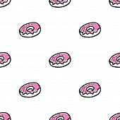 Seamless pattern with doodle doughnuts