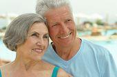 Senior couple by pool