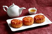 Mooncakes with a tea pot and tea c tea,Chinese mid autumn festival food.