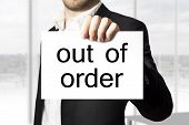 Businessman Holding Sign Out Of Order Burnout