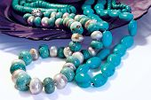 Turquoise Beads On Deep-blue Plat