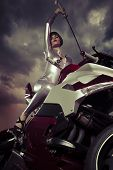 Warrior biker, Sensual and Beautiful brunette woman on a motorcycle