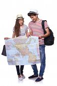 Couple of tourists looking destination on the map poster
