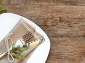Rustic Table Setting On Old Wooden Table