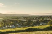 picture of hamlet  - Sunlit Hamlet near to California Cross Devon England - JPG