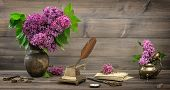 Still Life With Lilac Flowers And Antique Items