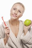 Blond Woman In Dressing Gown Cleaning Teeth With Manual Toothbrush