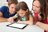 Family Using Digital Tablet With Blank Screen