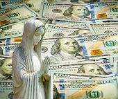 Praying Statue With Cash Background