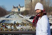 Winter Portrait Of A Woman At The Ottawa Rideau Canal With Love Locks