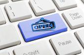 Blue open sign on keyboard