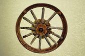 Cart Wheel Made Of Wood Vintage Background
