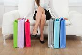 Woman With Multicolored Shopping Bags At Home