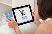 Woman With Credit Card Shopping Online On Digital Tablet