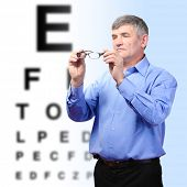 Medicine and vision concept - man with eye chart