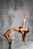 trendy street style dancer jumping on studio background