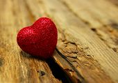 image of heartfelt  - Red heart on a background of wood - JPG