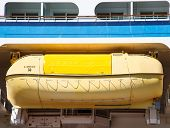 Yellow Lifeboat Under Blue Bulkhead