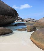 Unusual beach. Finest white sand beach between huge black cliffs and azure water. Similan Islands, A