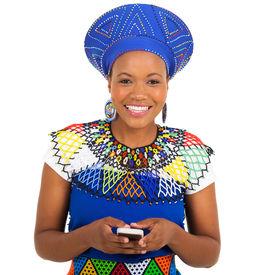 image of zulu  - beautiful south african zulu woman using smart phone on white background - JPG