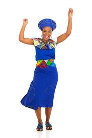 foto of zulu  - happy young african zulu woman dancing on white background - JPG