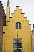 Bruges, Yellow Gable End Of Old Town House.