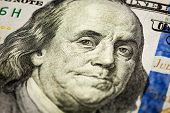 Macro shot of  Benjamin Franklin portrait from a $100 bill new 2013 year edition