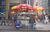 A hot dog stand vendor