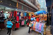 HONG KONG - DECEMBER 11, 2014: Hong Kong Special Administrative Region. On a narrow street of the old Hong Kong opened a large sale of clothing