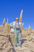 Senior tourist visiting Salar de Uyuni, Bolivia - Isla Incahuasi