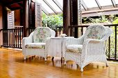 Outdoor Rest Area With White Nice Armchair Sofa,
