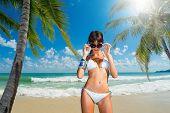 Beautiful woman on the tropical beach.