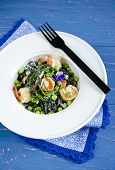 picture of cuttlefish  - Pasta with cuttlefish ink and vegetables on wooden table - JPG