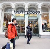 NEW YORK CITY - TUESDAY, DEC. 30, 2014: Pedestrians walk past a Bloomingdale's store. Bloomingdale's is an American upscale chain of department stores owned by Macy's, Inc.